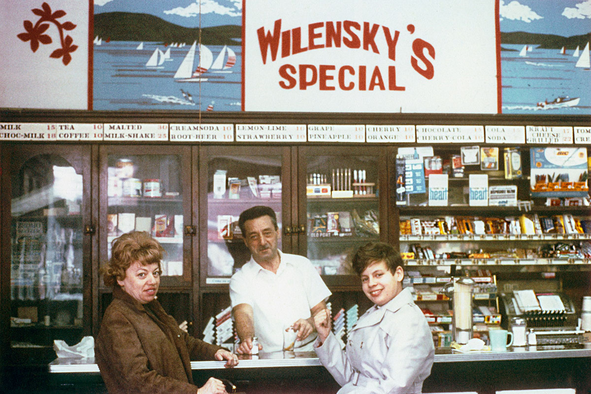 Anonymous, <i>Moe Wilensky and customers</i>, Montreal, 1965. Courtesy of the Wilensky family